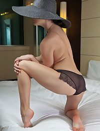 Wearing a wide brimmed hat, a chunky grain of necklace, added to a sheer ebony panty, Veranda exudes elegance painless A well painless A lusty romance painless A she sprawls enticingly on the bed.