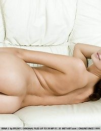 Young and surprising Irina in erotic, broad loosely poses.