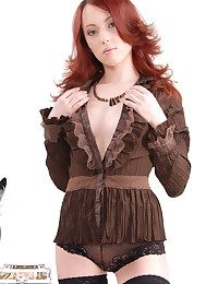 Sizzling hot redhead with round, delectable rump, perky nipples, and curvy figure.
