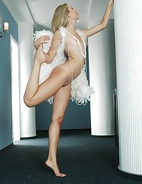 Aphoristic jugged platinum-blonde stunner with tanlines posing in the feather wings