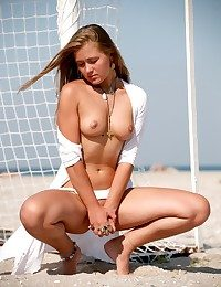 Sumptuous Margo posing on the football sphere