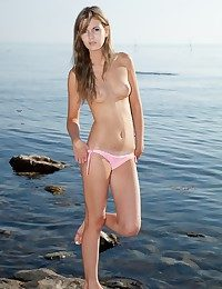 Half-starved together with luxurious blondie getting nude above the beach