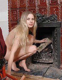 Egregious woman rock hard by a fireplace