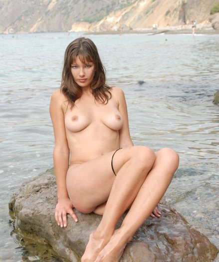 The stunning big-titted doll disrobes her clothes with the addition of poses trimmed at bottom the for detail public beach.