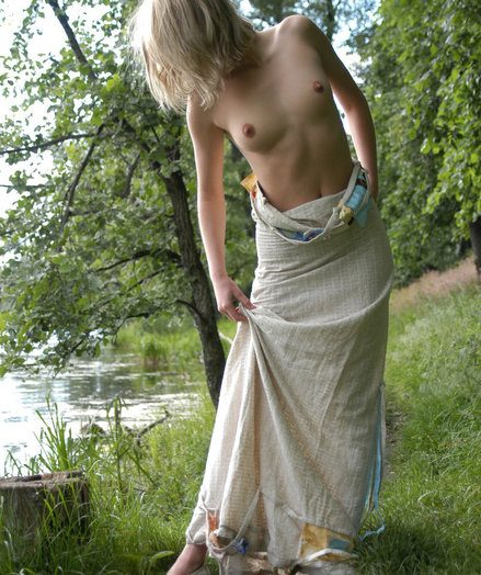 Ideal teenage enticing ash-blonde Nastya unwraps her sundress and poses bare on the bank of lake.