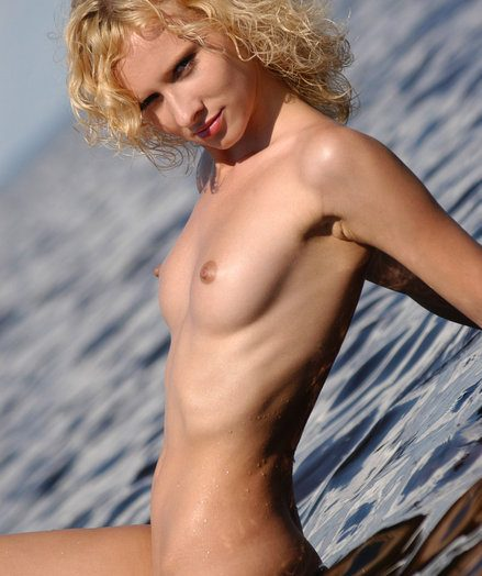 Crinkly ash-blonde dame seduces you with her brilliant figure on the fantastic water.