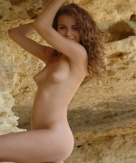 Ultra-cute curly bare damsel poses by a lengthy chalk surpassing chum around with annoy calcareous rocks.