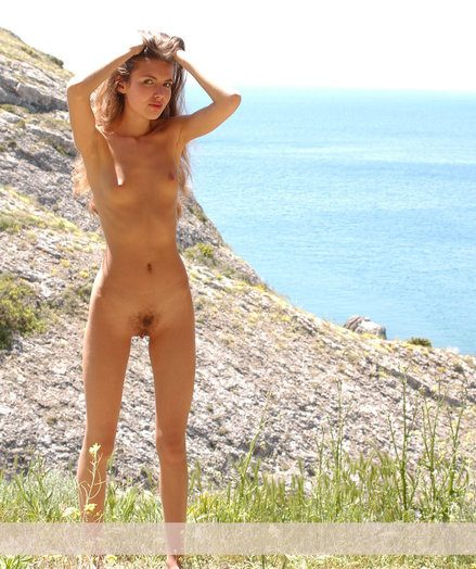 Fantastic wooly Alena strips her blue half-top added to undies added to poses bare greater than the ultra-cute cliff.