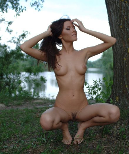 Nasty Kate displays the brush enticing vag near a lake.