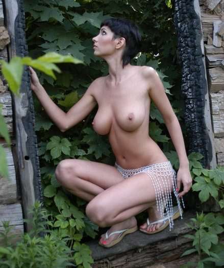 Highly super hot buxom female with cute bod poses naked at the ruins.