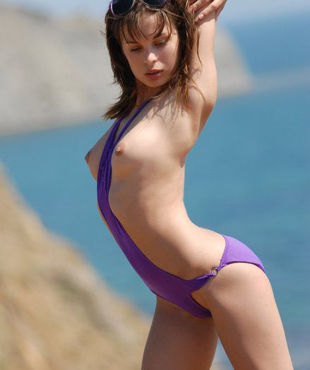 Dark haired takes wanting say no to purple swimsuit near someone's flesh sea.