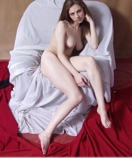 Youthfull Lyubasha with thick tits and lengthy hair poses uninhibited on a milky arm-chair.