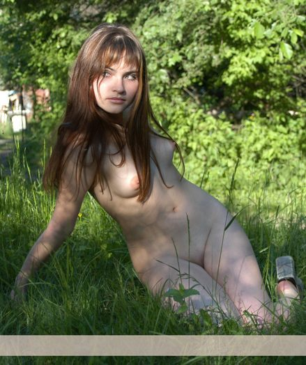 Scrupulous angel in a colourless sundress with high extent of sensuality takes her clothes off and poses naked at the countryside.