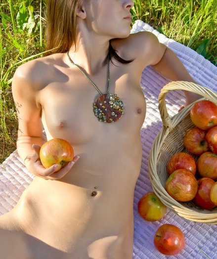 A extensive area glazed in lush, rural grass provides a brilliant setting for Bogdana's innate and laid-back allure as she sprawls expectedly with a bunch of ripe apples.