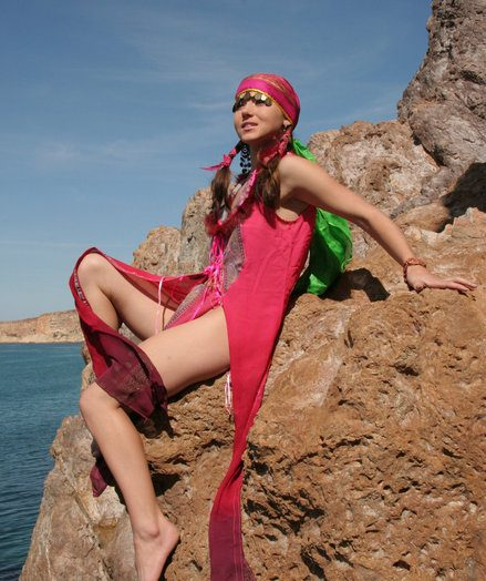Wearing her pots fanny costume, Firebird's alluring belle stands out painless she bravely poses along the rocky cliff by the sea.