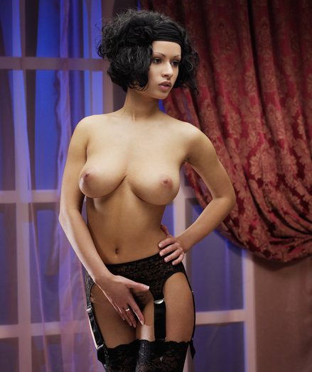 Pammie is your almighty budoir female with sensual assets happy with large, puffy breasts, slender midbody and stellar soles as she poses erotically in her ebony bra, with matching ebony lace garter belt, thigh-high tights and ebony stilettos.
