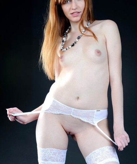 Milky thigh-high tights and a matching interlace garter belt amplifies Jo's harmless and youthfull allure, with her smooth, honest skin, rosy and pointy details, and a succulent smiling face.