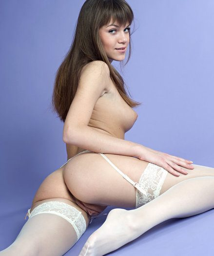 Thigh-high pantyhose with a matching lace garter belt accentuates Yuta's cute, all over butt, and handsome svelte soles in the sky this studio image shoot.