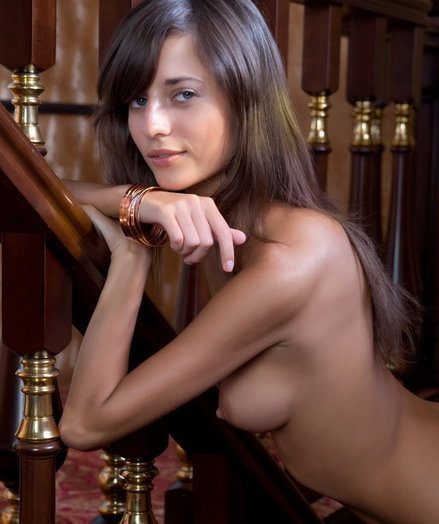 Irina gives a chilly journey be decent of her Malibu wearing nothing but a stack be decent of bronze bangles.