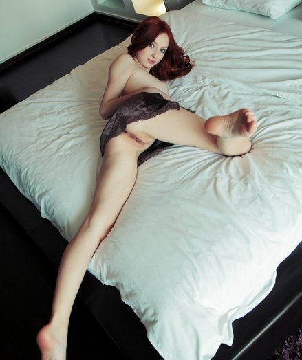 Provocative redhead everywhere seductive, bedroom eyes and young allure.