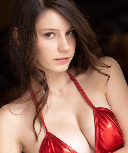 Charming, girl-next-door sweetheart in molten torrid pleather costume.