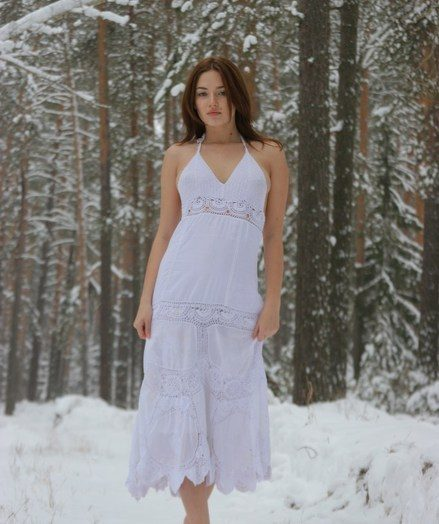 Enticing and unhibited, Lena frolics surpassing the white, cold snow.