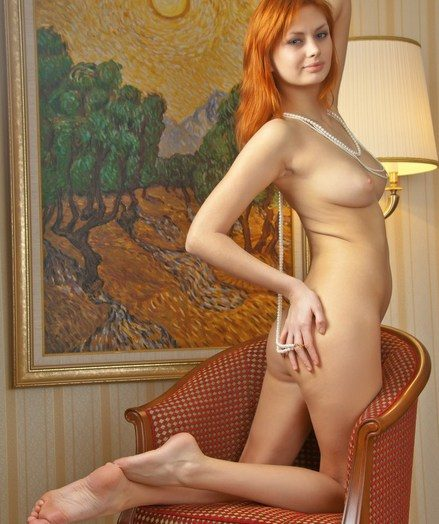 Appealing redhead with sleek pallid flesh and limber assets.