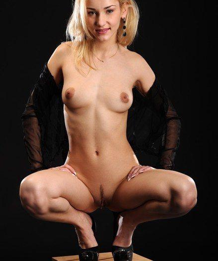 Sensual and softcore model in stellar dark-hued sheer lingerie.