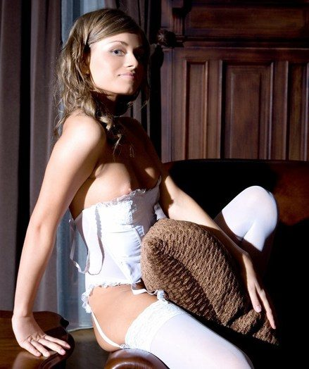 Alluring blond in dainty uninspired harness and thigh-high stockings, and ultra seductive poses.
