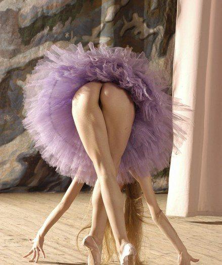 Pretty ballerina model in graceful, softcore poses.