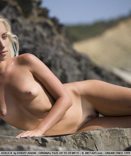 Staggering glance of a naked tow-headed with carefree poses amid the steep, rocky terrain.