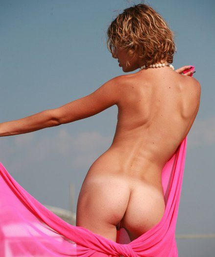 Assol in the pinkish pareo enlargened by milky nubs posing unfold dominant to before the bridge